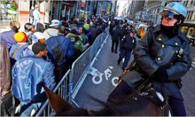 Mounted police were called out to control the crowd of thousands seeking 65 full-time jobs (Andrea Mohin/The New York Times/Redux)